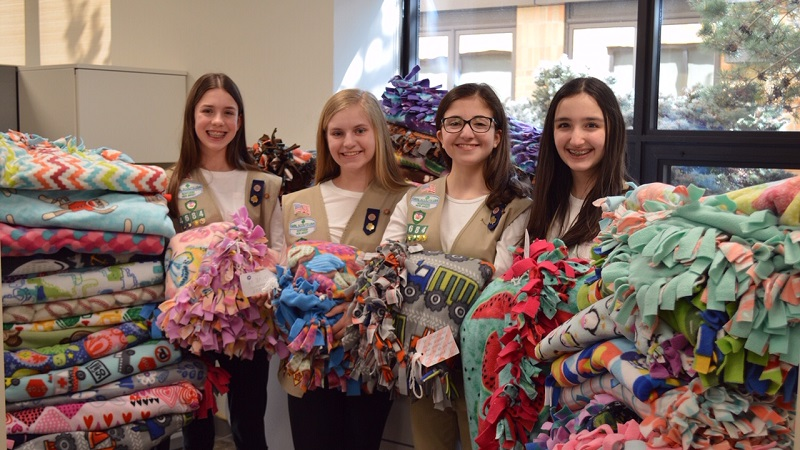 Girl Scouts with their blanket donations