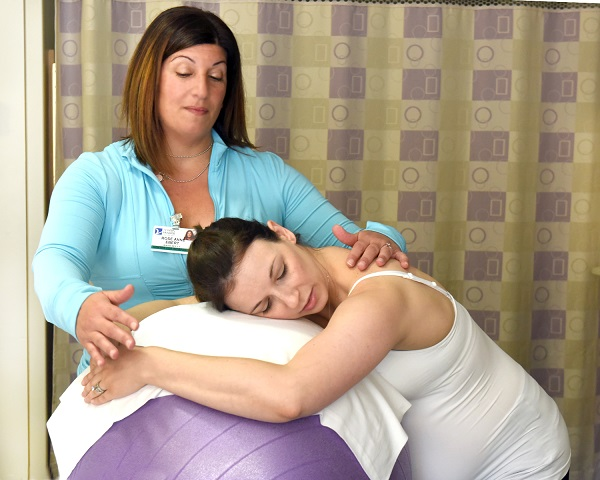 Doula assisting with childbirth at The Valley Hospital