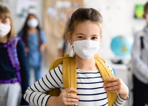 girl in school, wearing facemask