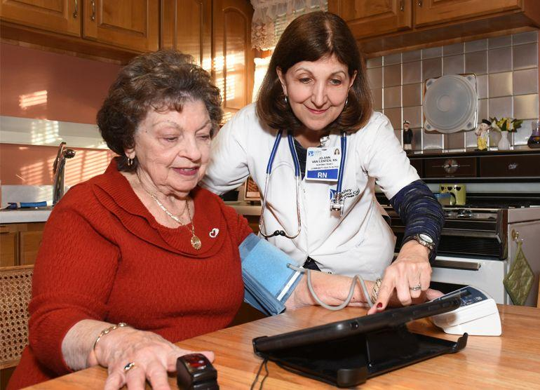 Nurse helping elderly woman